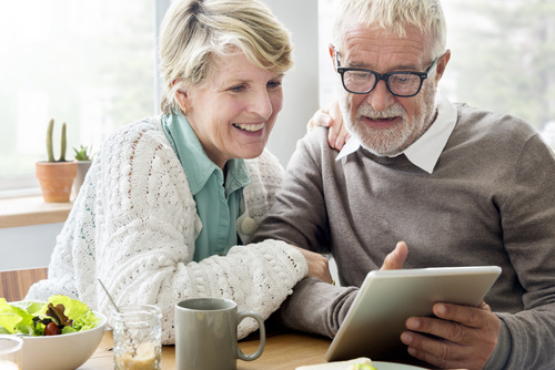 Senior Adult using Digital Device Tablet Concept